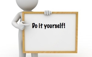 Figure holding board that says: do it yourself